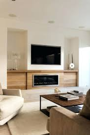 modern tv above fireplace design ideas and combo built cabinet