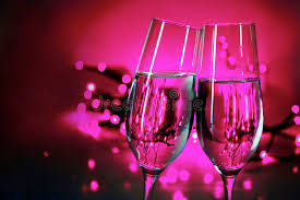 new years chagne flutes two chagne flutes clink glasses on new year s party purple b