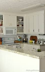 White Laminate Kitchen Cabinets How To Re Paint Your Yucky White Cabinets