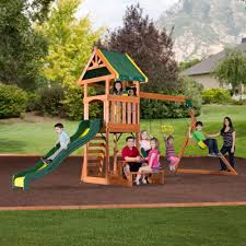 exterior white wooden fence with backyard playsets and natural