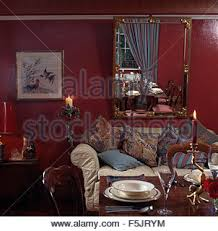 Dark Red Dining Room by Red Sofa In An Old Fashioned Nineties Living Room With Swagged