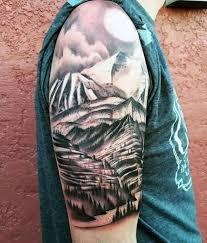 brilliant mountains with sun on half sleeve