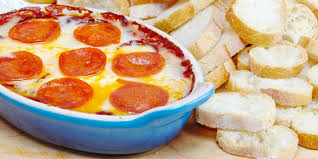 this pizza dip is the ultimate party starter