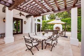 spanish style houses spanish style back patio statement making pergola photos diy