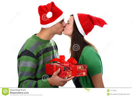 young couple kiss in santa hats isolated on white stock image