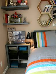 teen boy bedroom ideas with nightstand and read lamp plus unique