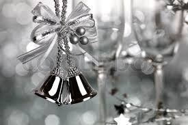 bells and two empty wineglass on silver background