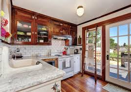 white kitchen cabinets wood trim vintage kitchen cabinets and white tile back splash trim 120989924