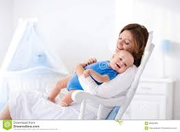 White Bedroom Rocking Chair Happy Young Mother With Baby Boy At Home Stock Photo Image 68062899