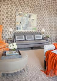 gray linen sofa with swoop arms flanked by gray end tables