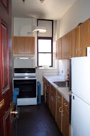 great brown hardwood kitchen cabinets set also white wall painted