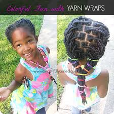 hair style with color yarn beautifully curled adding a touch of color to yarn wraps