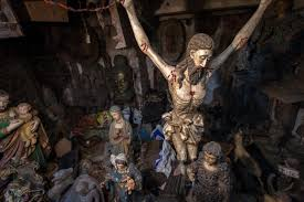 brett cole photography a wooden figure of jesus on the cross