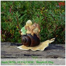everyday collection resin lying on snail garden