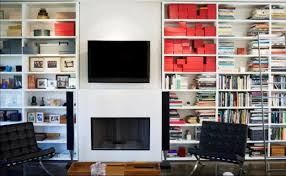 decorations white mounted bookshelf on the white wall with