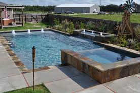 this southwest style rustic pool and spa features geometric design