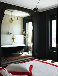 black clawfoot tub green notebook