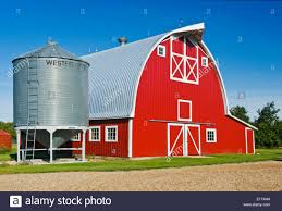 red barn and grain bin near humboldt saskatchewan canada stock