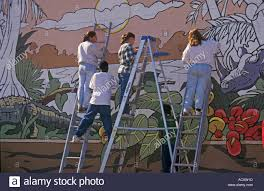 youth paint mural on wall between detroit and grosse pointe stock stock photo youth paint mural on wall between detroit and grosse pointe