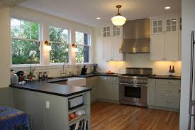 kitchen windows over sink storage banked on the opposite wall allows the expansive windows