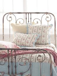 more interested in the wrought iron bed than the quilt for the