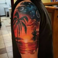 gorgeous colored lonely tree with sunset tattoo on leg body art
