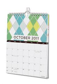 How To Hang Pictures On A Wall Hang A Wall Calendar Using Command Clear Mini Hooks Clear