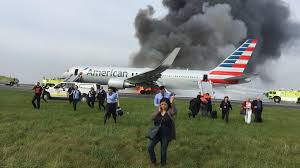 20 injured as american airlines jet catches fire at chicago u0027s o
