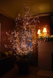 decorating beautiful lighted branches for home accessories ideas lighted branches plus wall light and brown wall for home interior design ideas