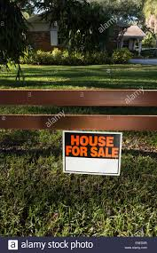 ranch style house with for sale sign on front decorative wooden