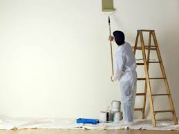 a quick approach on using a paint roller go paint sprayer man painting wall with roller