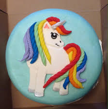 unicorn rainbow rainbow haired unicorn birthday cake white cake with smooth
