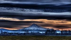 dark village wallpaper field mountain clouds setting dark rural village fields beautiful