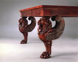 four massive mahogany tables with carved lion u0027s head legs
