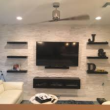 Table For Under Wall Mounted Tv by Furniture Wall Mount Entertainment Center With Brick Wall Also