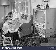 Tv In Living Room 1950s Boy And Watching Tv In Living Room Stock Photo Royalty