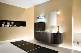modern luxury bathroom with warm lighting and large stone walls