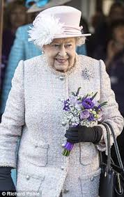 queen elizabeth ii beams after winning a a 98 voucher from the queen takes posy from labrador in visit to dog charity daily