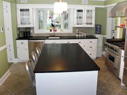 kitchen and bath island kitchens with cabinets and light granite glass access door