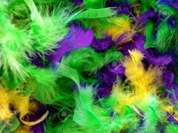 green mardi gras feathers in bright mardi gras colors of green purple and gold