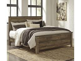 signature design by ashley trinell rustic look king panel bed