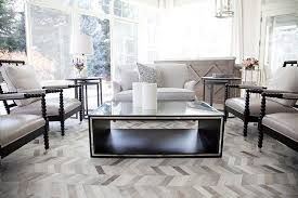 matching coffee table and end tables gray linen wingback chairs and nesting end tables transitional