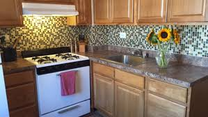 tiles backsplash tan kitchen backsplash white shaker cabinets