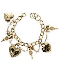double heart charm bracelet images Lyst guess gold tone heart and key charm bracelet in metallic jpeg