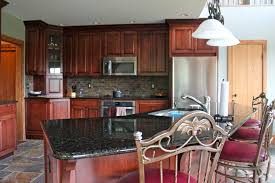 cabin remodeling what color granite with natural cherry cabinets