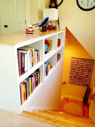 2 sided bookshelf in place of railing at top of stairs in my home