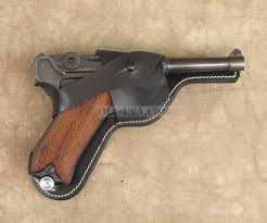 figure 2 luger pistol and magazine loading that magazine is a
