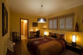 modern master bedroom design with cool recessed lighting and