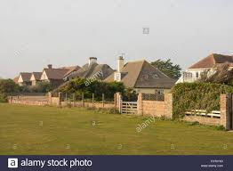 large mansions large houses and mansions behind brick walls fences and hedges on
