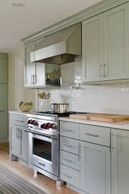 green kitchen cabinets with white countertops soothing green kitchen features green cabinets paired